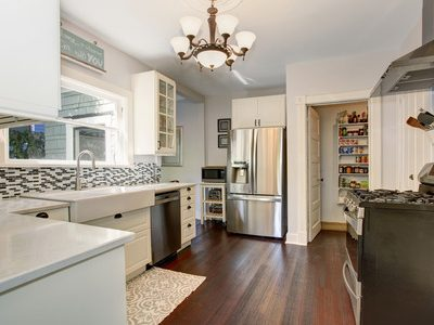 60296666 - white kitchen room with stainless steel fridge and hardwood floor. view of a pantry.